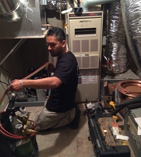 Mario of M&M Welding the Refrigeration Lines
