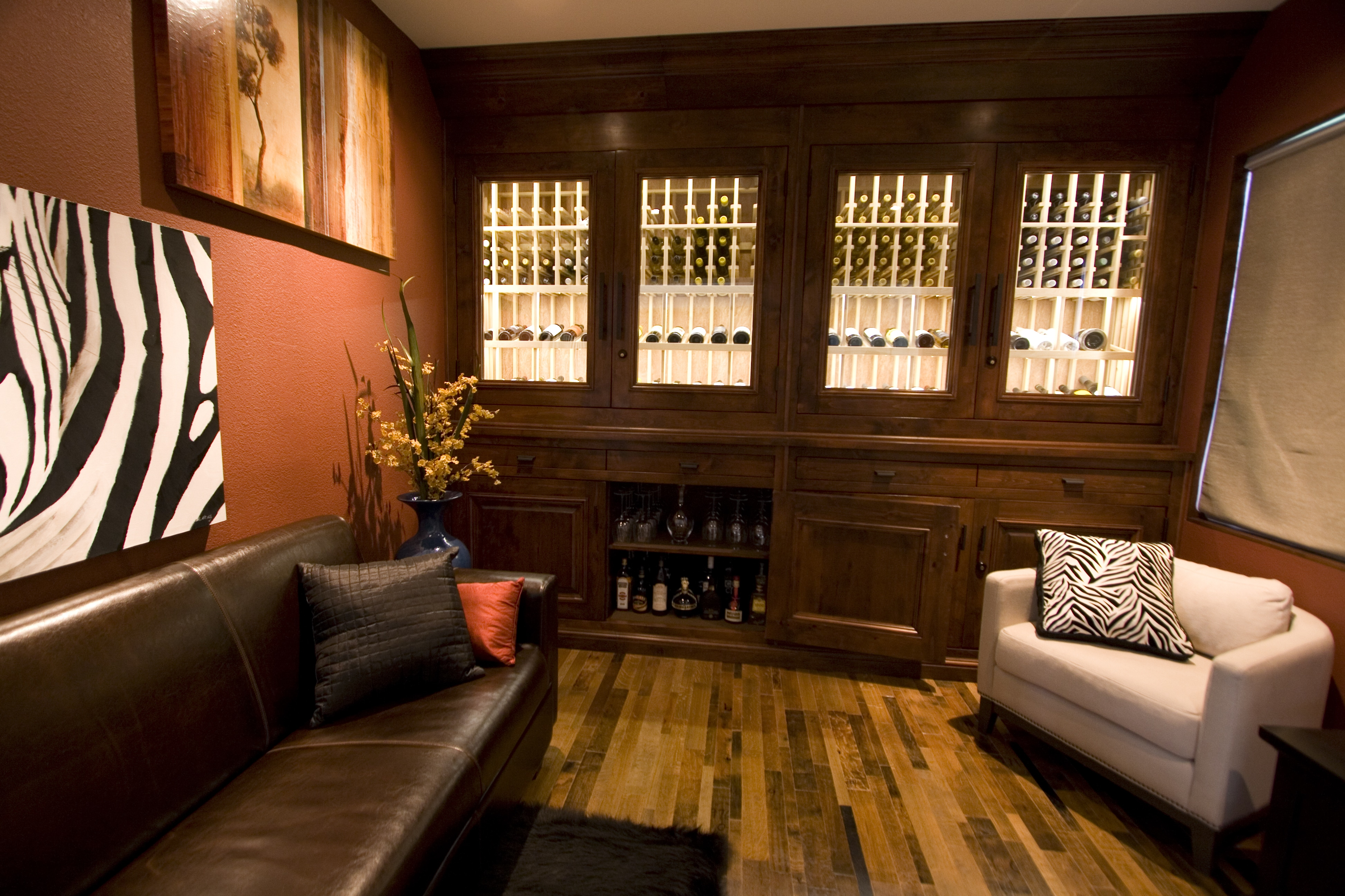 The type of material used for a wine cellar's flooring can help accentuate the overall design of the storage room. The most popular choices of materials include old wine barrels and natural cork planks.