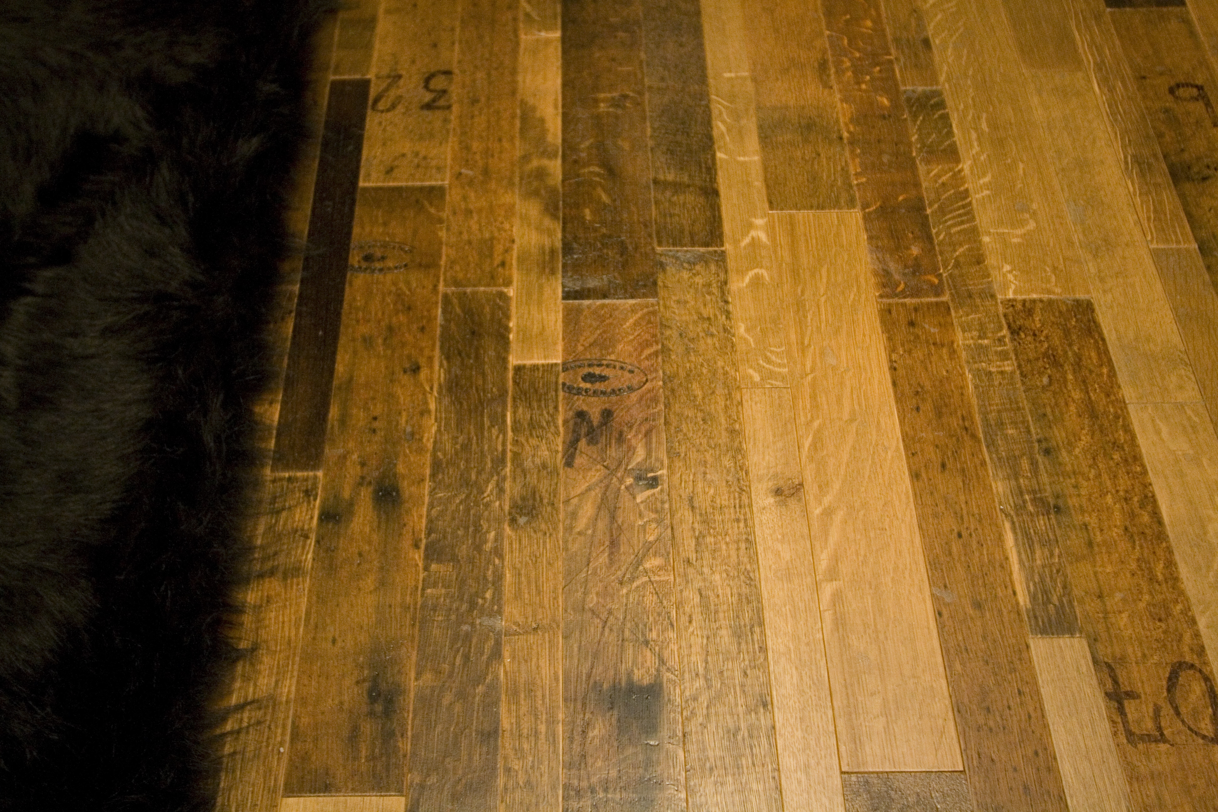 Reclaimed oak wine barrel flooring is one of the most popular choices. Not only is the material beautiful, it is also eco-friendly.
