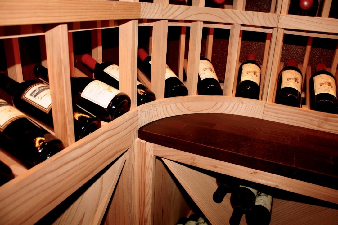 Redwood Custom Wine Cellar Racks with a Reclaimed Barrel Tabletop Los Angeles