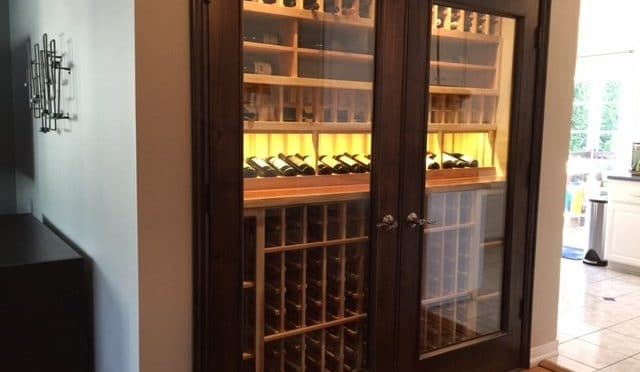 How Wine Room Design Experts Transformed a Kitchen Area into a Glass Home Wine Cellar in Los Angeles