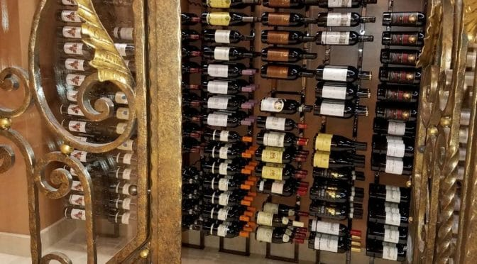 & Striking Wine Cellar in Irvine with Floor to Ceiling Metal Wine Racks