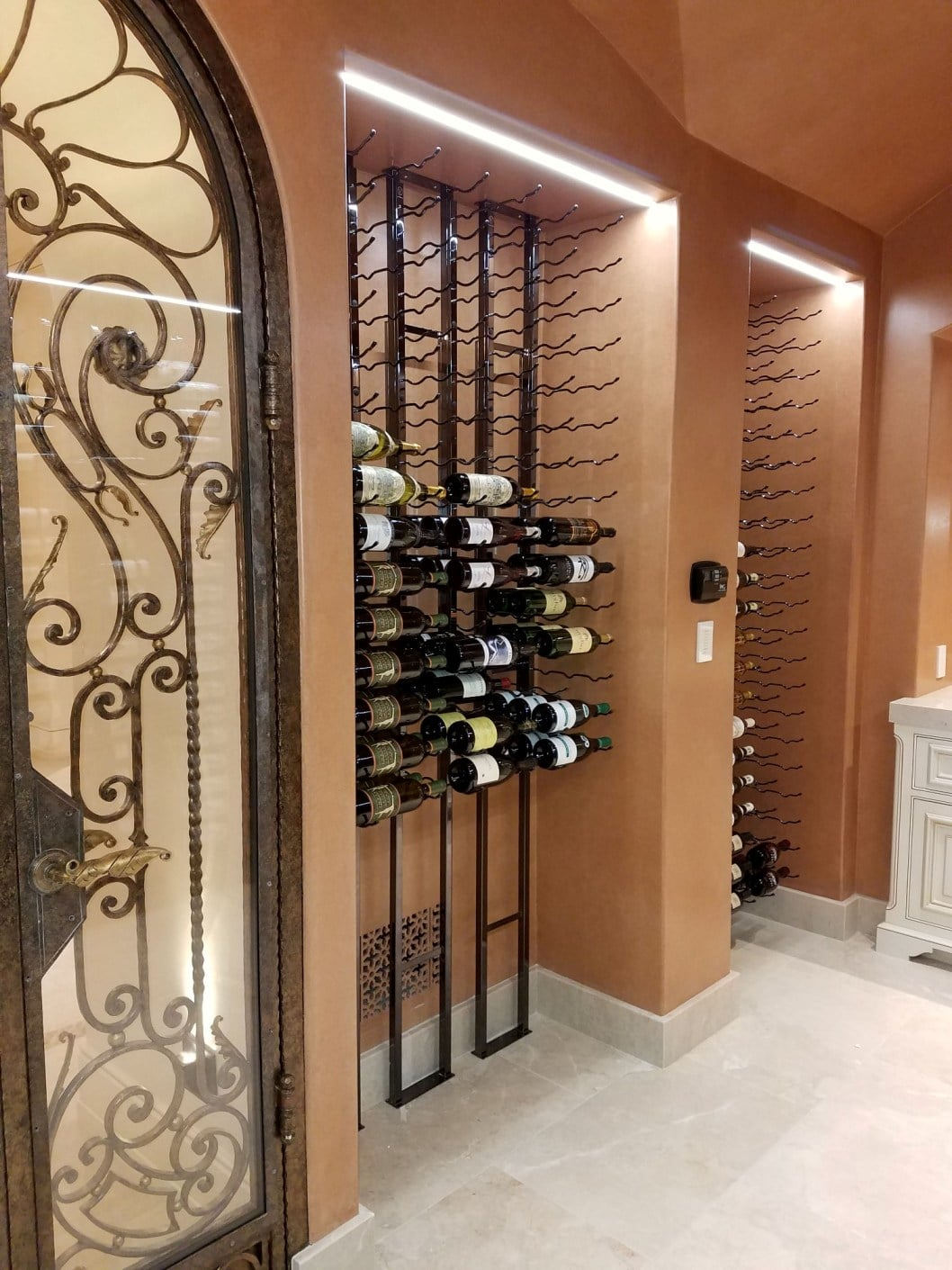 Striking wine cellar in irvine with floor to ceiling metal for Wine cellar in floor