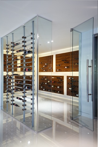Contemporary Wine Cellar with Glass Walls and Metal Wine Racks Los Angeles