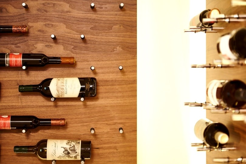 Label-Forward Contemporary Peg Wine Racks Designed by Los Angeles Master Builders