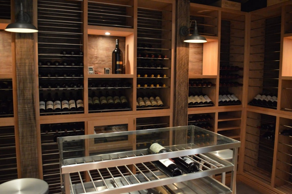 Los Angeles Home Wine Cellar with Efficient Cooling Unit and Stylish Custom Wine Racks
