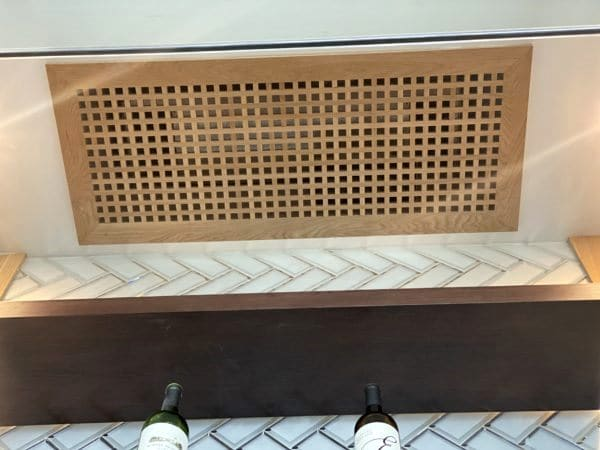 White Oak Wooden Grill Covers Conceals the Fan Coils Glass Wine Cellar Project Los Angeles