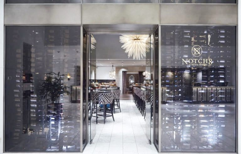 This Glass-Enclosed Refrigerated Commercial Wine Cellar with Contemporary Wine Racks is a Perfect Addition to the High-End Hotel
