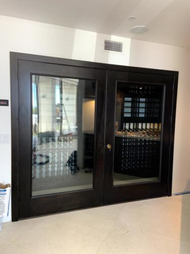 glass front wooden wine racking los angeles