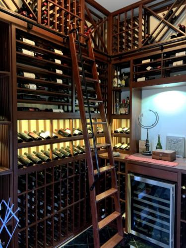 traditional wine closet with rolling ladder